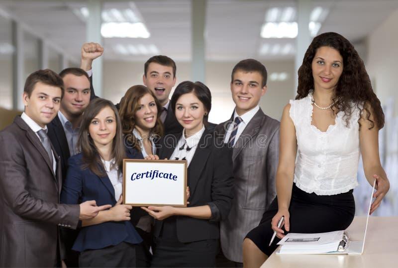 年轻企业队和女性辅导员 库存照片