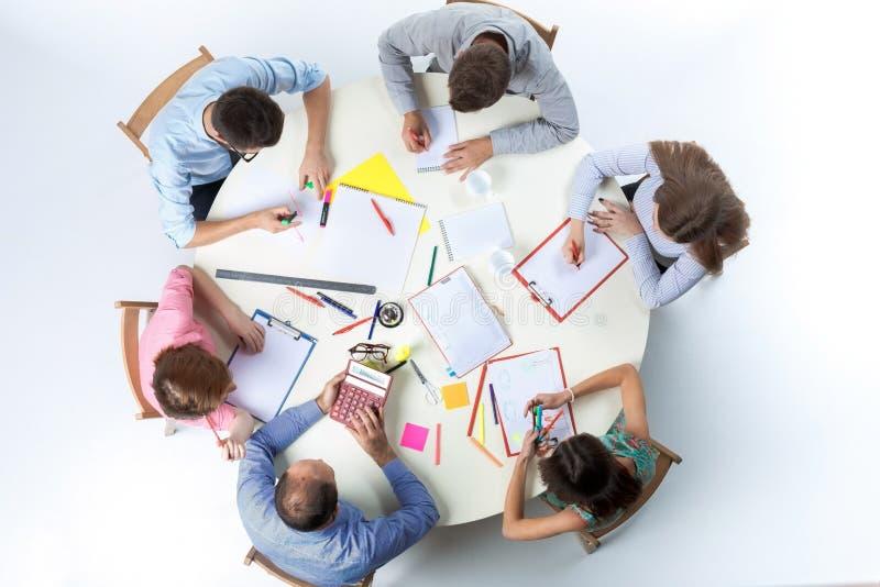 企业队顶视图在工作区背景的 免版税图库摄影