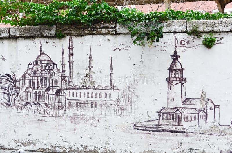 伊斯坦布尔,土耳其,2018年9月25日- 与伊斯坦布尔的标志的街道画-清真寺和少女塔 艺术五颜六色的包括的街道画街道墙壁 免版税库存图片