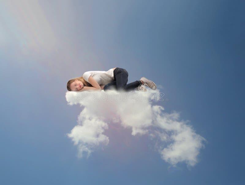 休眠在云彩的女孩 库存图片