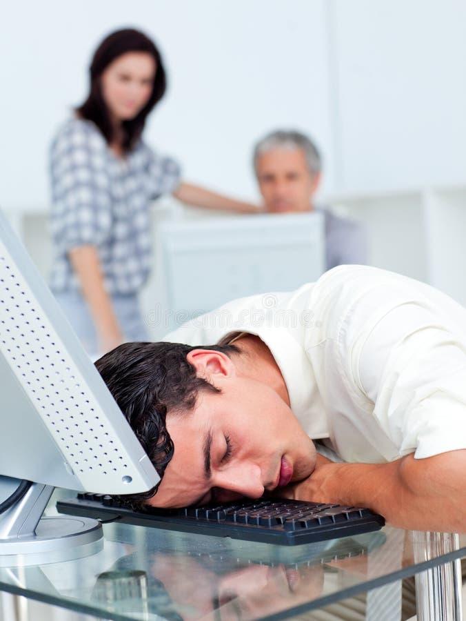 休眠在他的关键董事会的生意人 免版税库存照片