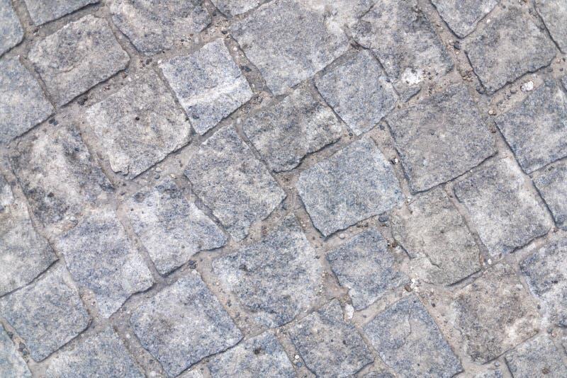 优秀石墙背景:鹅卵石地道走道 免版税库存图片