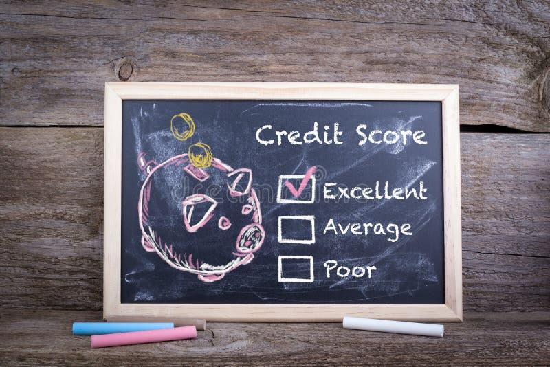 优秀,信用评分概念 粉笔板背景 图库摄影