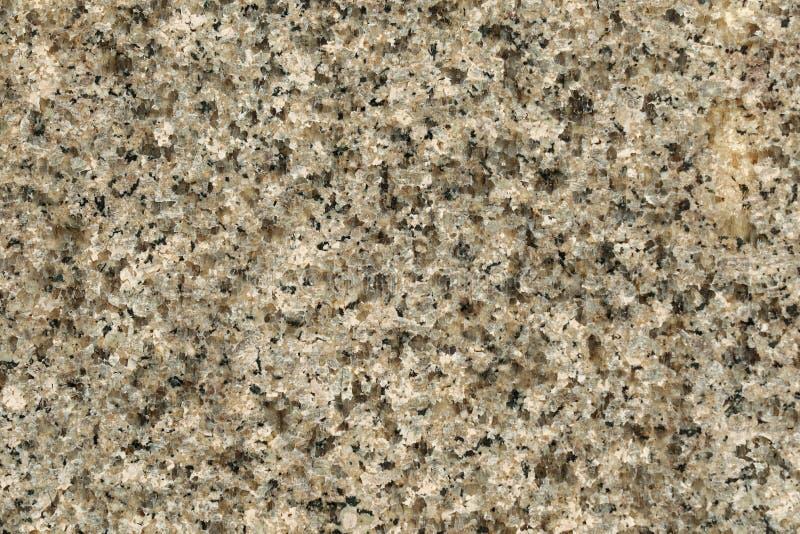优美的花岗岩岩石纹理在灰色黑色的 na背景  免版税库存图片
