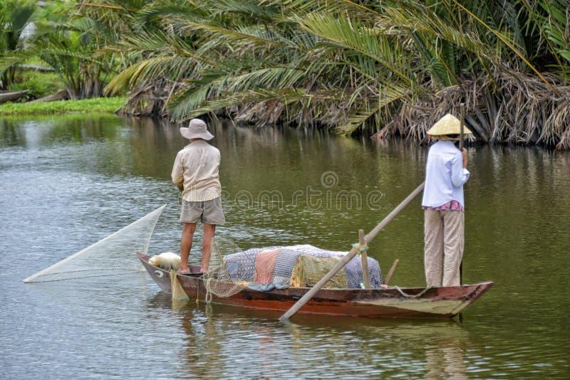会安市河的,越南渔夫 库存照片