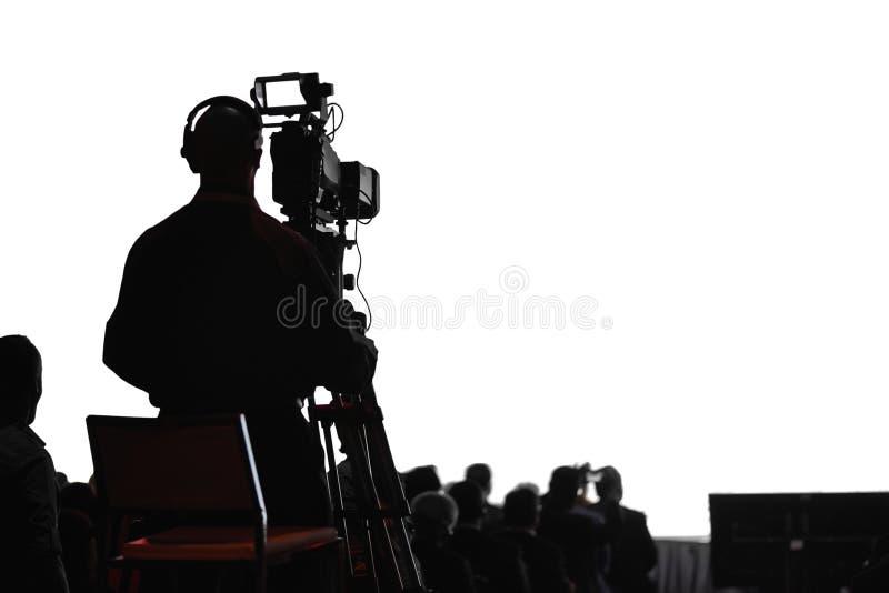 会议生产摄影师剪影 免版税库存图片