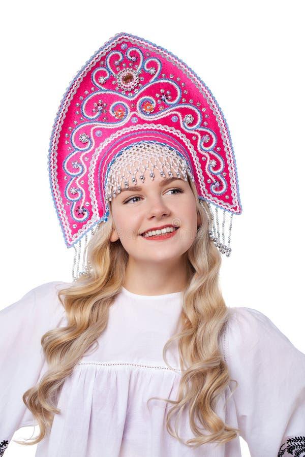 传统俄国民间服装,一年轻美女的画象 图库摄影