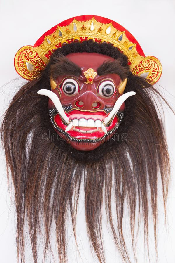传统在白色隔绝的巴厘语木面具 免版税库存图片