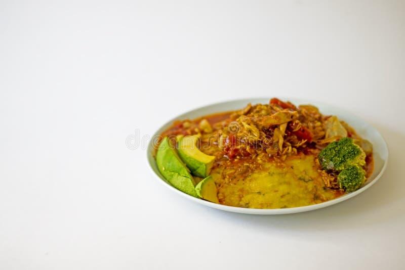 传统巴巴多斯当地食物秋葵玉米面Cou-Cou用鸡汤 库存照片