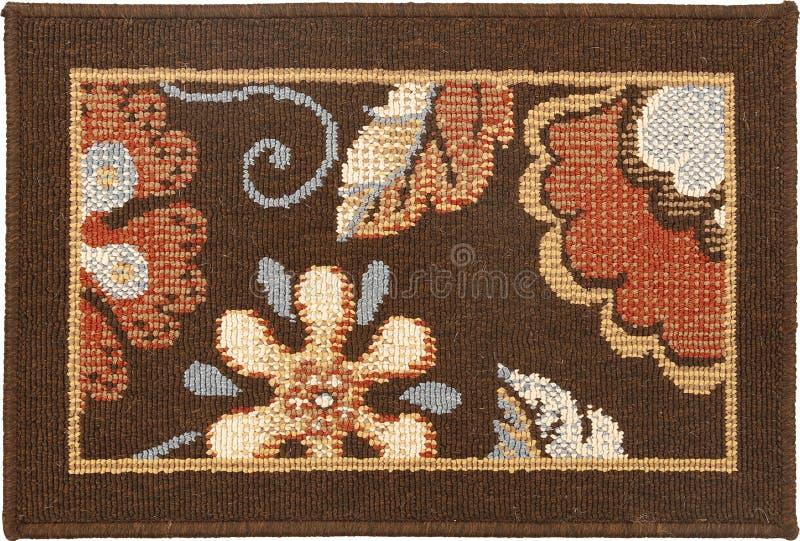 传统棕色花羊毛擦鞋垫 免版税库存照片
