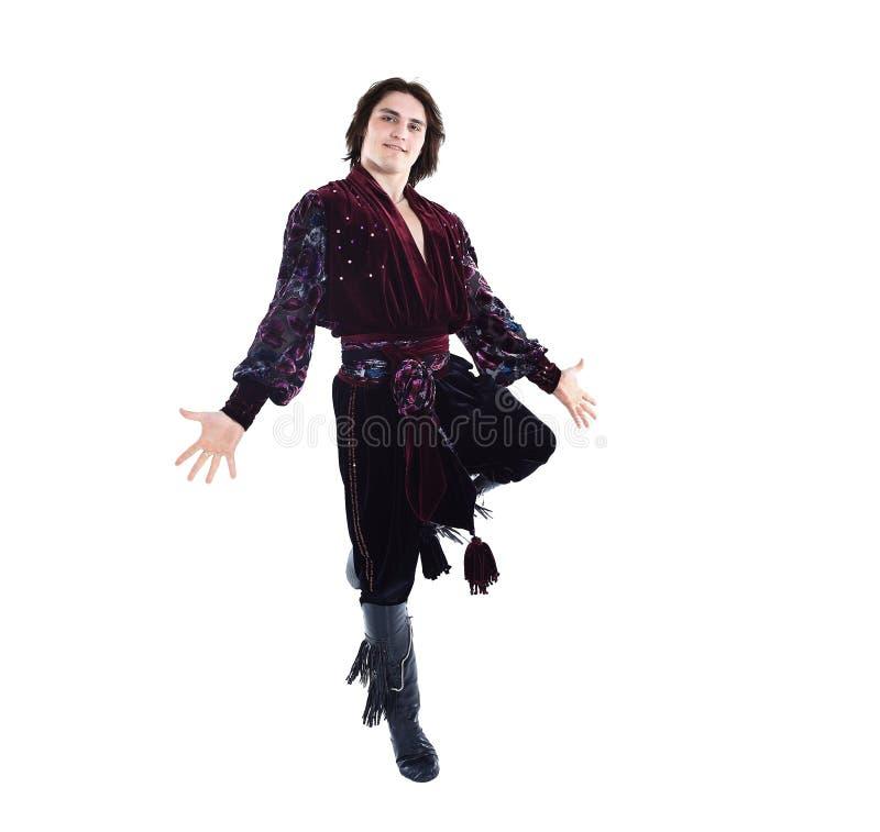 传统礼服的吉普赛男性舞蹈家进行民间舞 免版税图库摄影