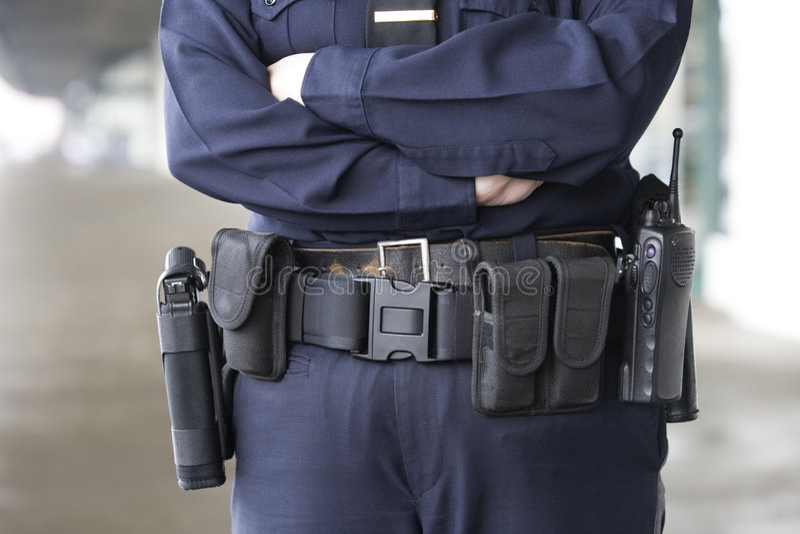 传送带设备她的女警统一 免版税库存图片