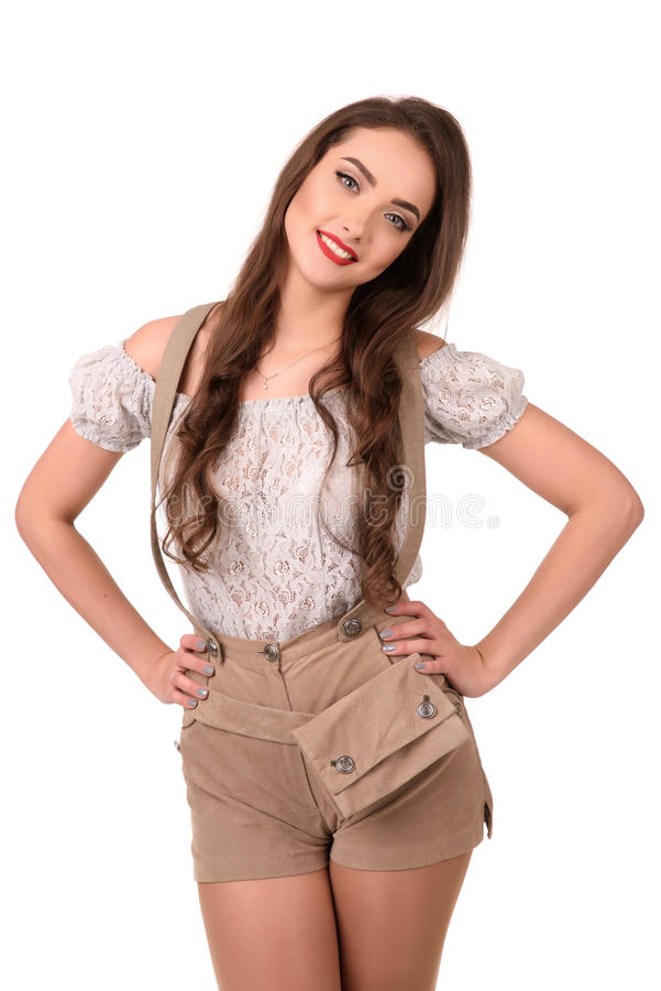 传统德国服装的美丽的性感的年轻深色的女孩 库存图片