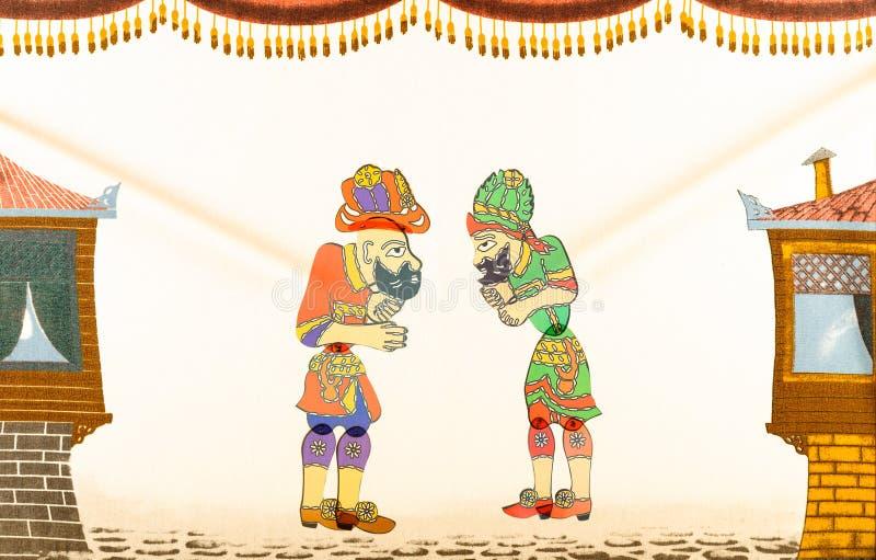 传统老赖买丹月木偶戏土耳其语Hacivat Karagoz oyunu场面 免版税库存照片