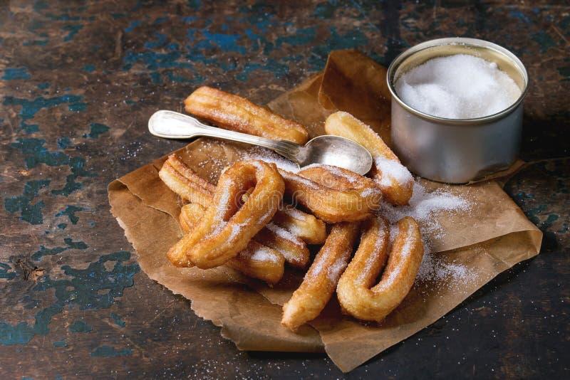 传统西班牙churros用糖 免版税图库摄影