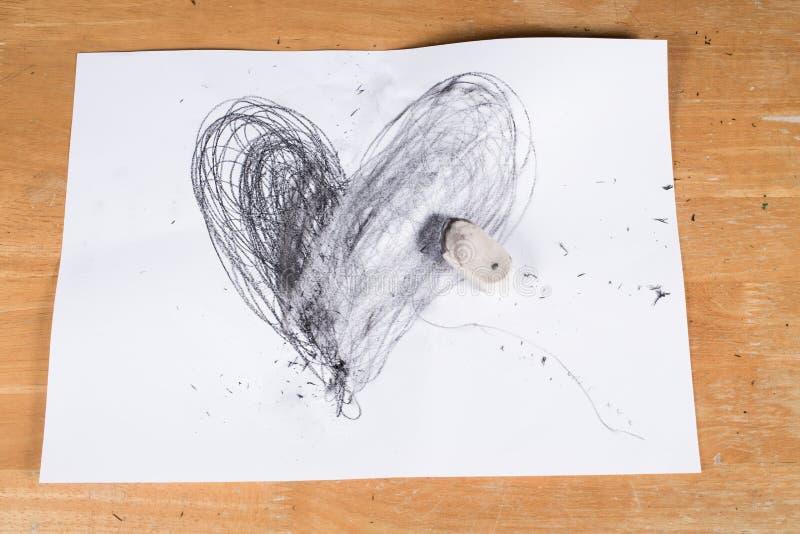伤心,橡皮擦删除的心脏 库存图片