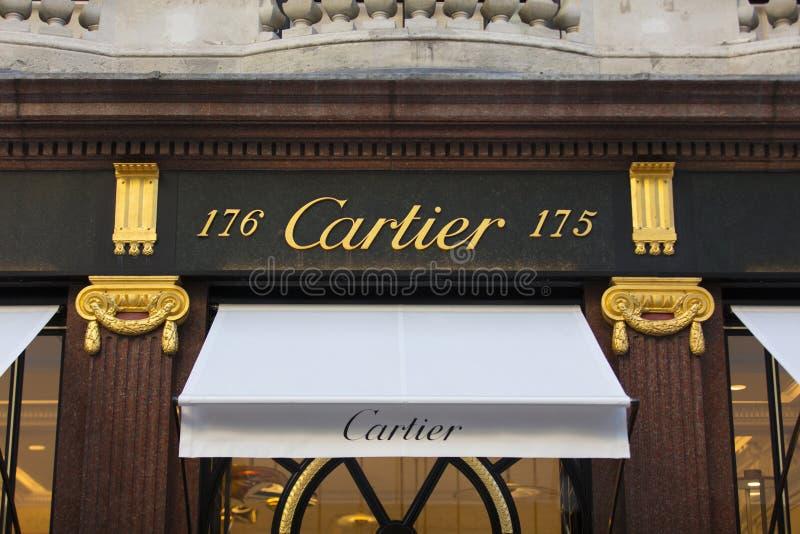 伦敦、大伦敦、英国、2018年2月7日,一个标志和商标政券街道卡蒂尔商店的 库存图片