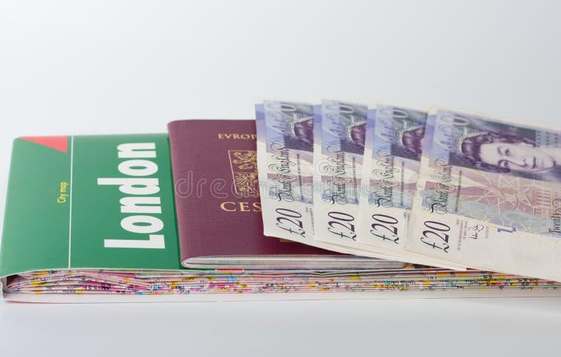 伦敦、护照和英磅地图  库存照片