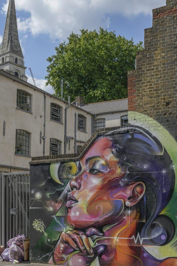 伦敦-在砖车道地区,妇女画象附近的街道艺术 图库摄影