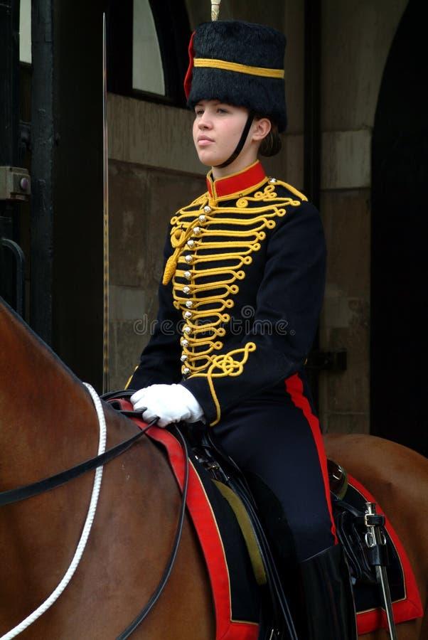 伦敦-在马的女性卫兵 免版税图库摄影