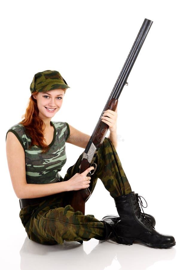 伪装加工好的绿色妇女 免版税库存图片