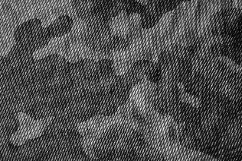 伪装样式在黑白的布料纹理 免版税库存照片
