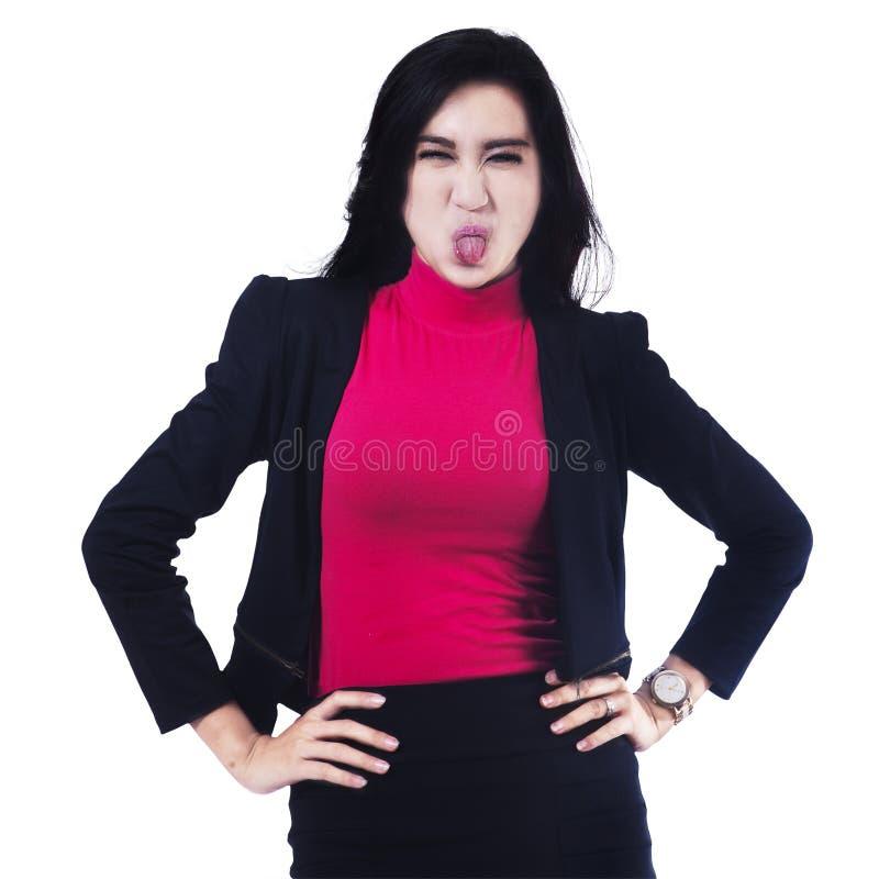 伸出舌头的女实业家 库存图片