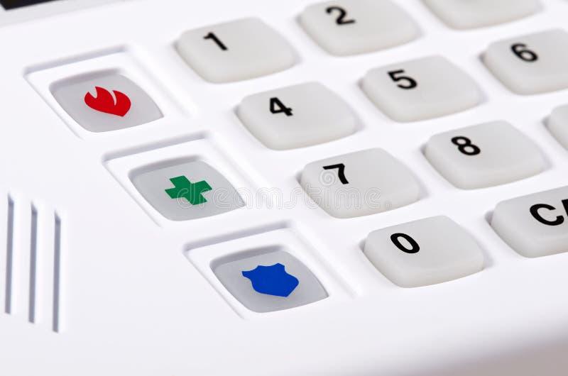 住家安全与紧急按钮的预警键盘 免版税库存图片