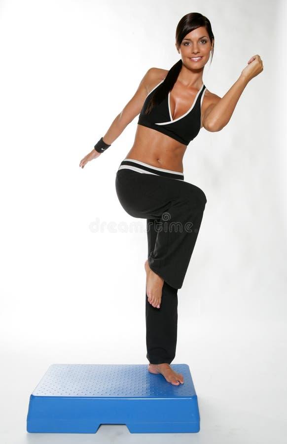 体操妇女运作的年轻人 免版税库存照片