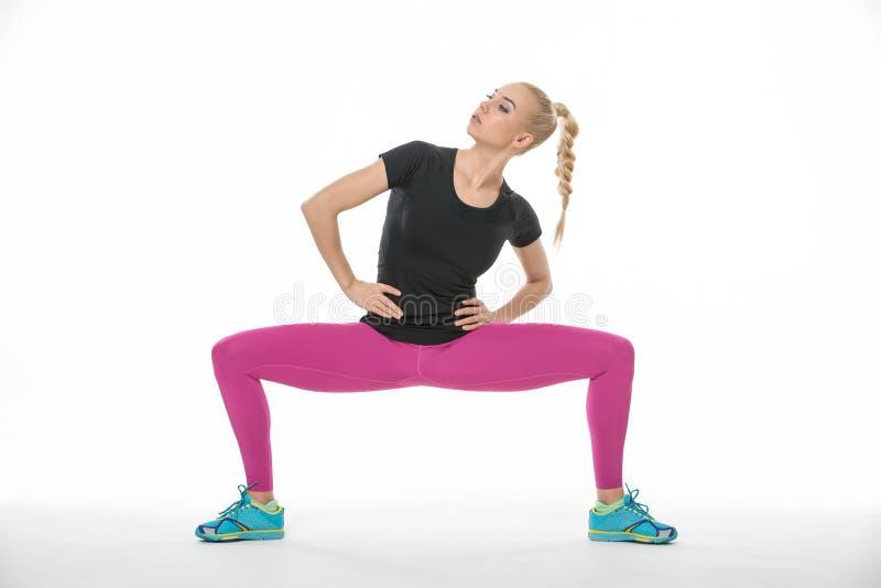 体操运动员女孩的锻炼 免版税图库摄影
