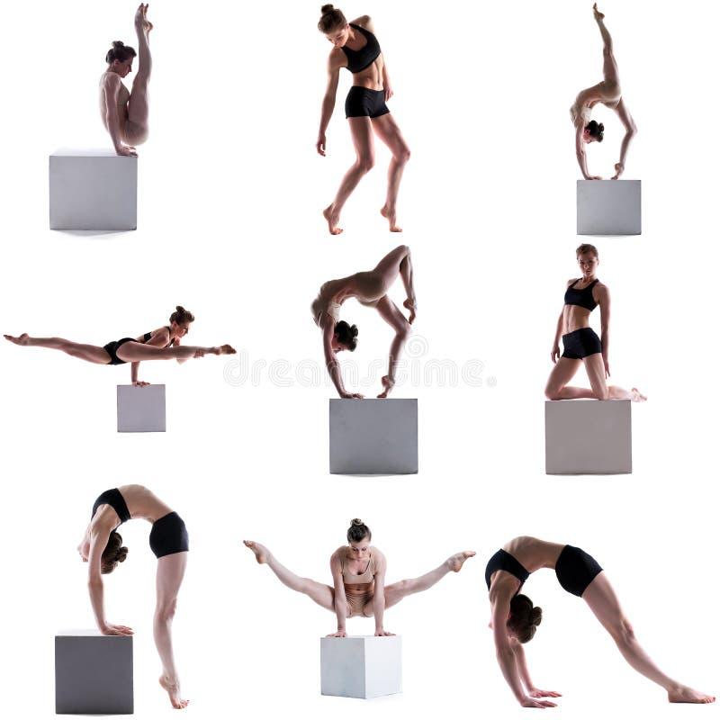 体操 灵活的女孩摆在立方体的套 库存照片