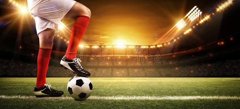 体育场的足球运动员 库存图片