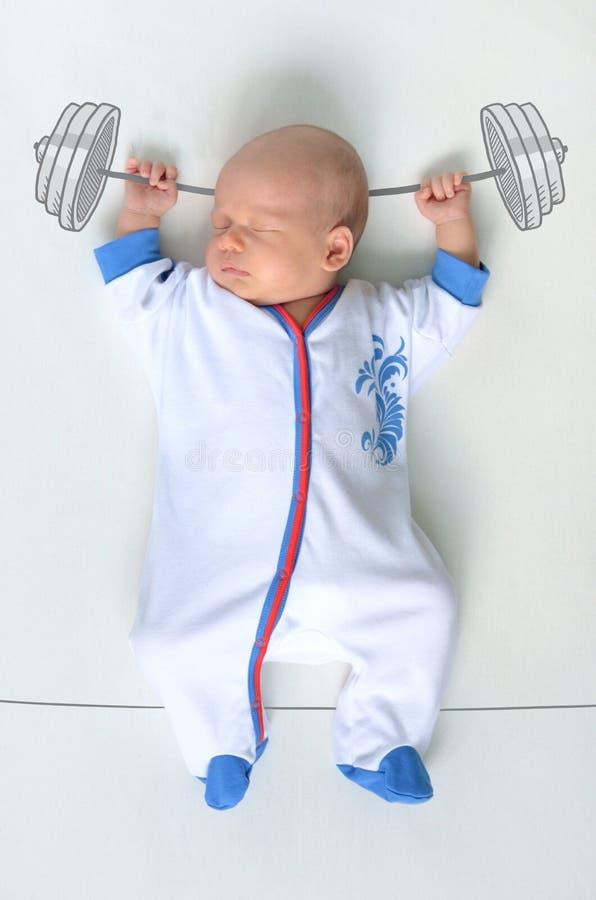 体育服装的重量级的冠军婴孩 免版税图库摄影