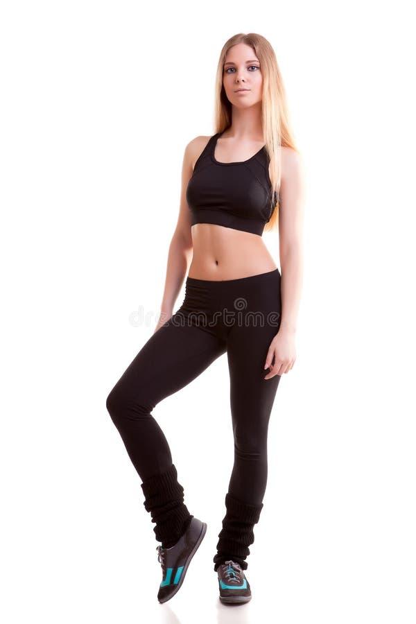 体育穿戴的妇女充分的身体在白色背景 免版税库存图片