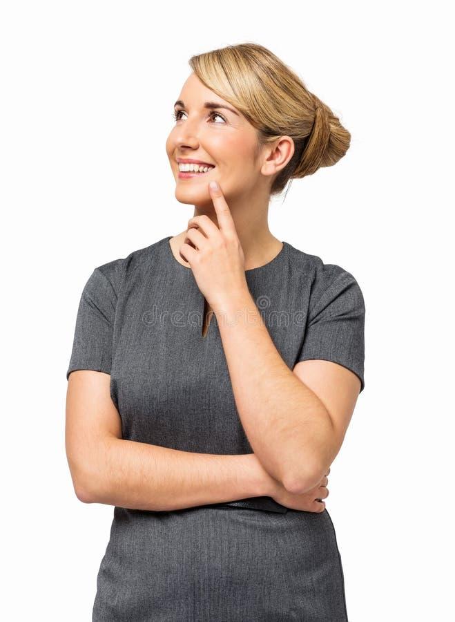 体贴的女实业家用在奇恩角微笑的手 库存图片