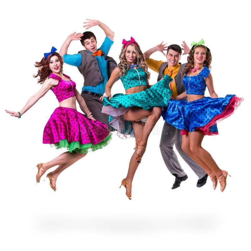 余兴节目舞蹈家队跳跃 查出在全长的空白背景 库存照片