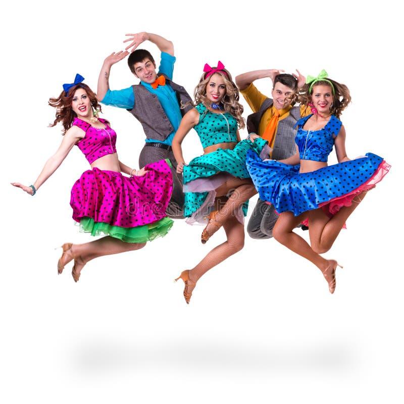 余兴节目舞蹈家队跳跃 查出在白色 免版税库存图片