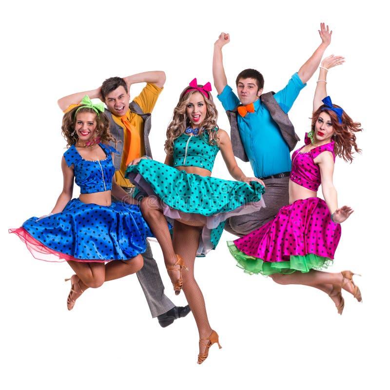 余兴节目舞蹈家队跳跃 查出在白色 免版税库存照片