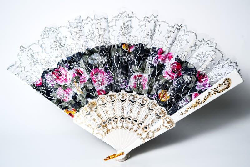 佛拉明柯舞曲与在白色背景隔绝的五颜六色的样式的手爱好者 免版税库存图片