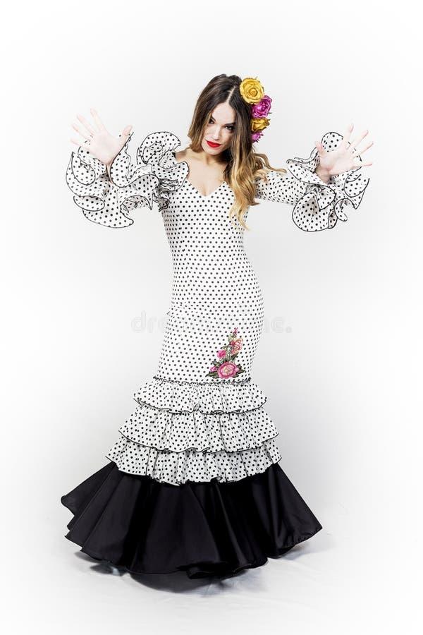 年轻佛拉明柯舞曲舞蹈家画象美丽的礼服的 免版税库存照片