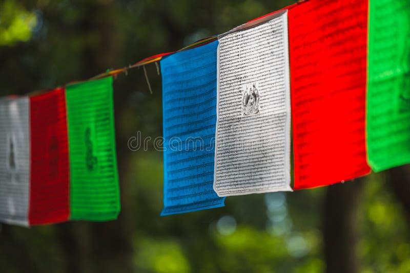 佛教五颜六色的标志祷告 免版税库存照片