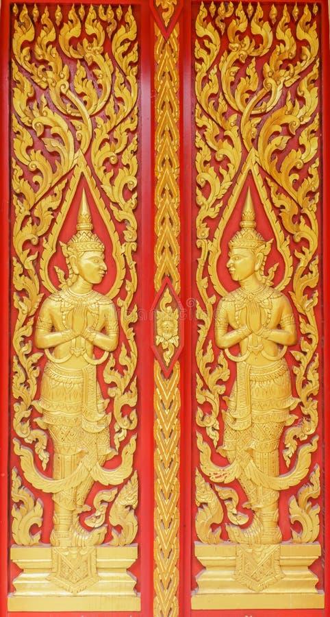 佛教寺庙门的天使装饰在素叻他尼,泰国 库存图片