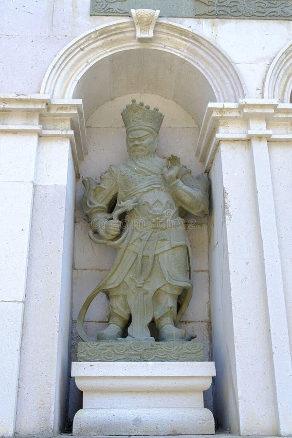 佛教的四位国王的石雕象 免版税图库摄影