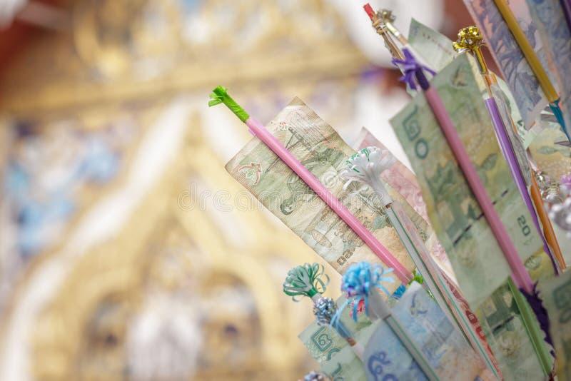 佛教节日的传统;与一装饰timb的钞票 免版税库存照片