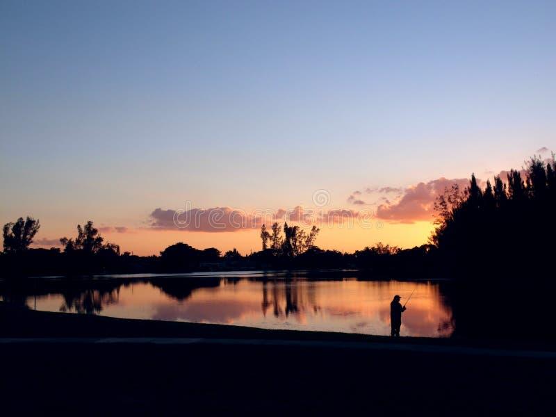 佛罗里达日落和渔夫 库存照片