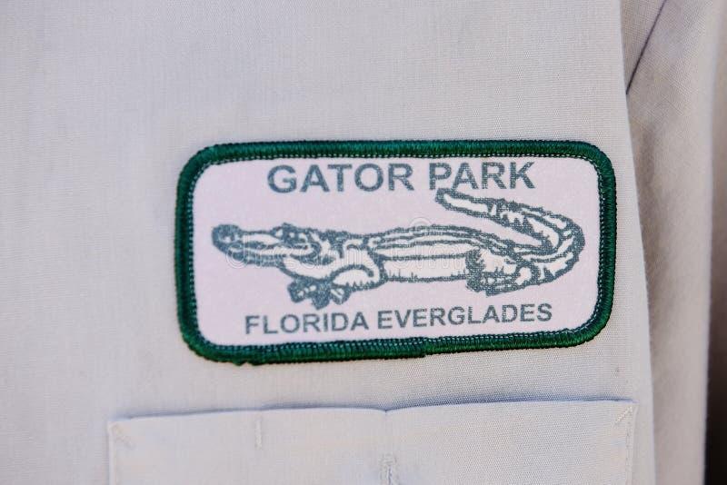佛罗里达状态鳄鱼公园沼泽地职员徽章 库存图片