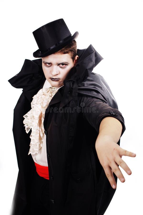 作为万圣节的一个吸血鬼打扮的肥胖少年 库存照片