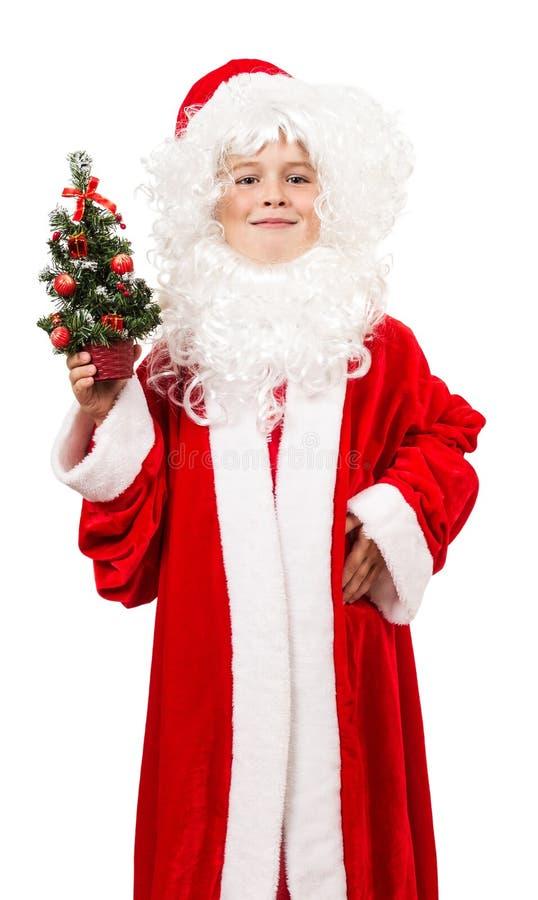作为与装饰圣诞节的圣诞老人打扮的男孩 库存图片