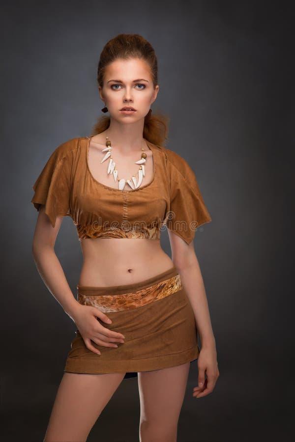 作为亚马逊打扮的美丽的妇女 库存照片