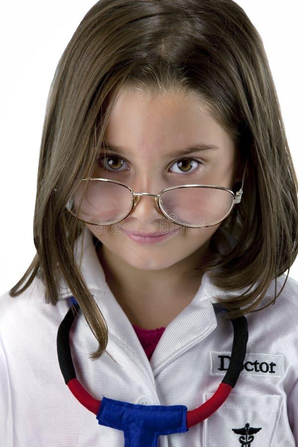 作为医生加工好的女孩一点 免版税图库摄影